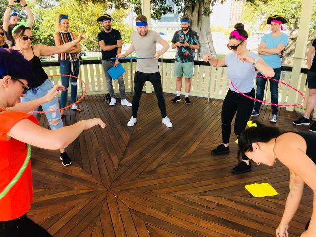 Hula Hoop Hula-ing fun amazing race fun team building activities pn the Sydney through The Rocks Mystery Mix event